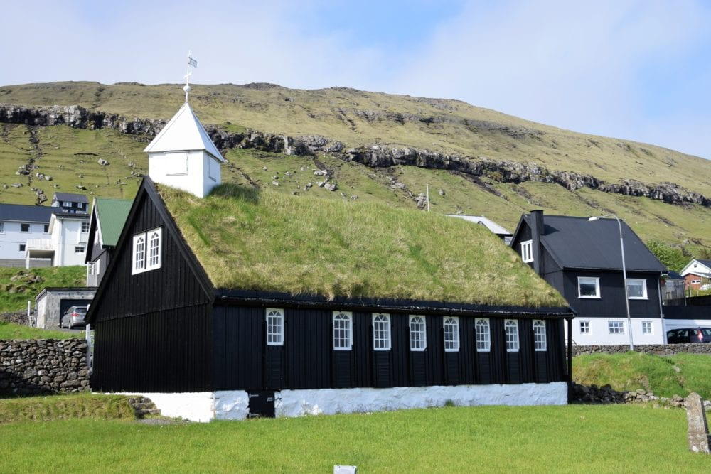 Green turf covered church with pyramid capped tower, Faroe Islands