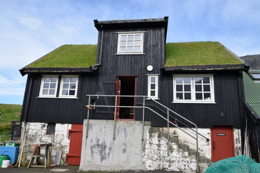 A typical timber house with green turf roof, Faroe Islands