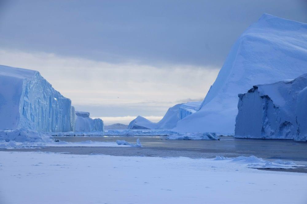 Gigantic icebergs under a very grey sky at Disko Bay