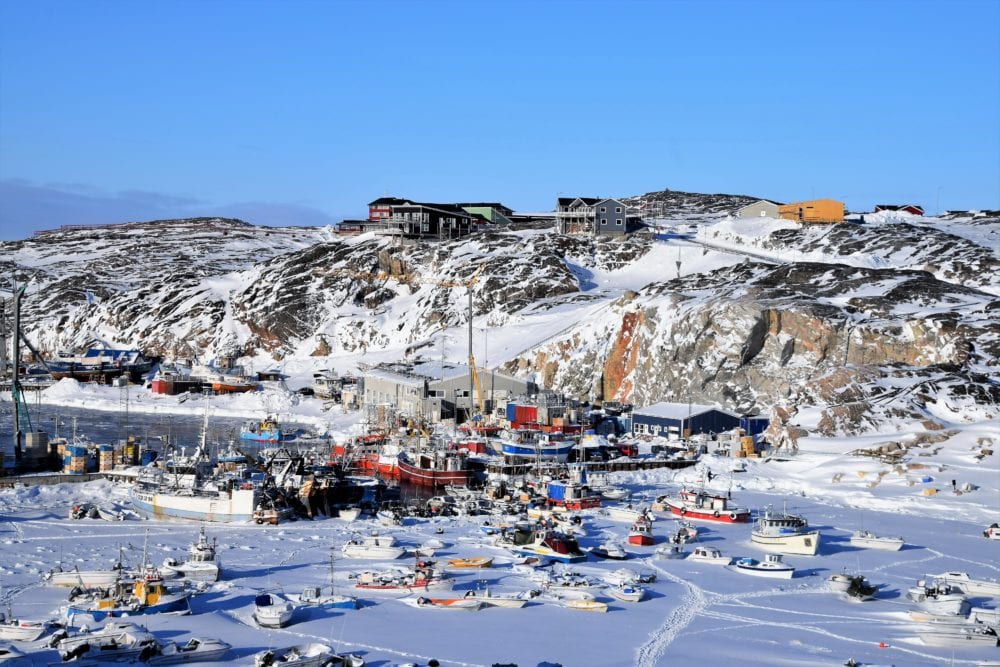 A view across the harbour and icebound boats at Ilulissat, Greenland