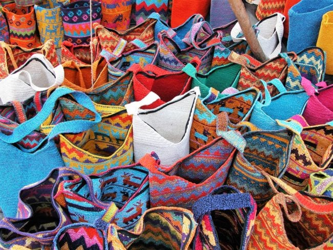 Rows of bright woven baskets on a stall at Chichicastenango, Guatemala
