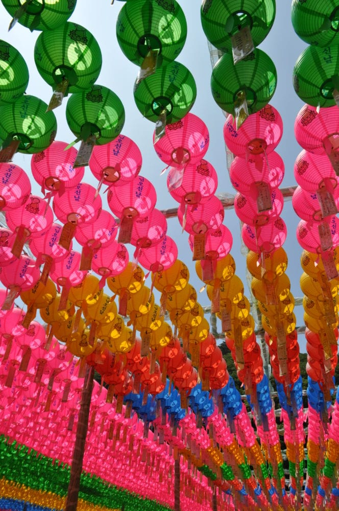 Rows of bright lanterns decorate the ceiling of a temple in Gyeongju