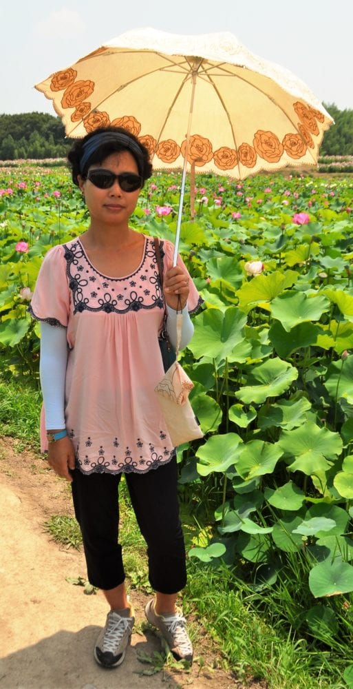 Lae with her umbrella in the lotus fields, Gyeongju