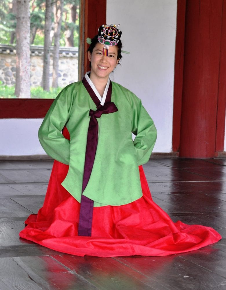 A student dressed in traditional costume at the restored village at Gyeongju