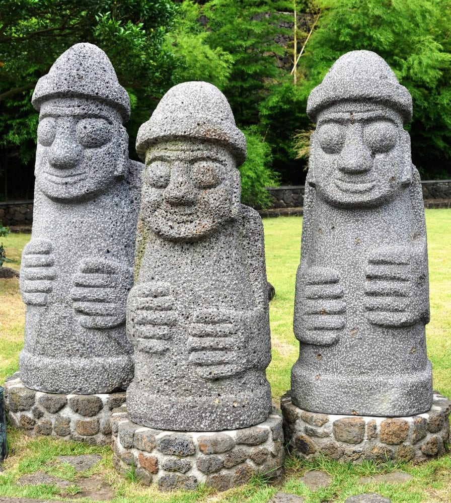 Carved stone figures at the bonsai garden Jeju