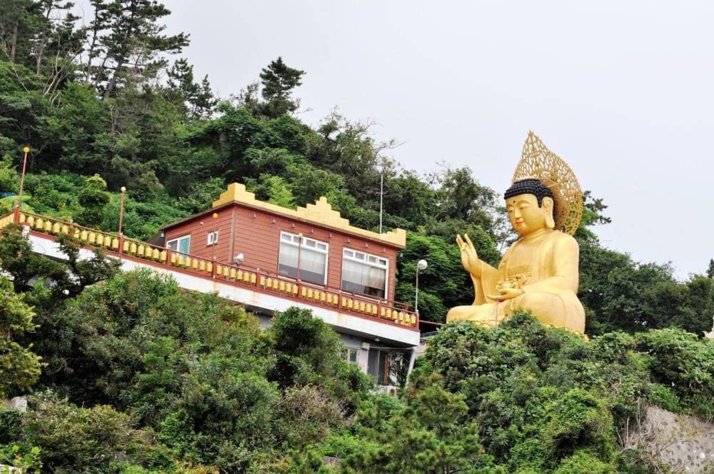 Modern Buddhist temple with large Buddha statue on Jeju