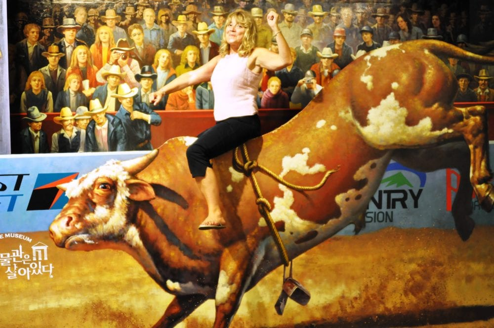 Sue on the back of a rodeo bull at the Alive Museum, Jeju, South Korea