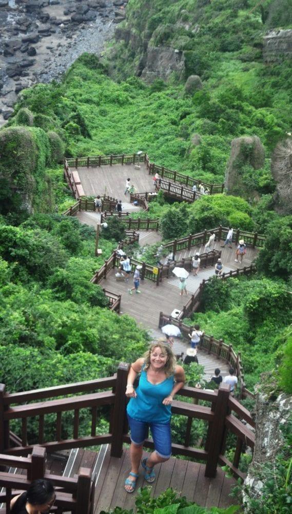 Sue climbing the steep staircase at at Seongsan Ilchulbong, Jeju. South Korea