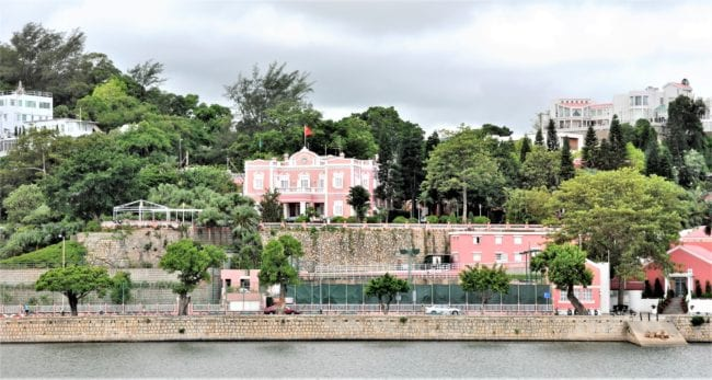 Pink and white government house, taken form the water Macau