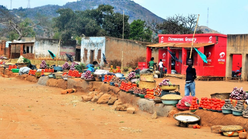 Colourful vegetables piled along the side of the road in Malawi