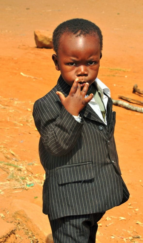A young boy wearing a stripy suit in Malawi