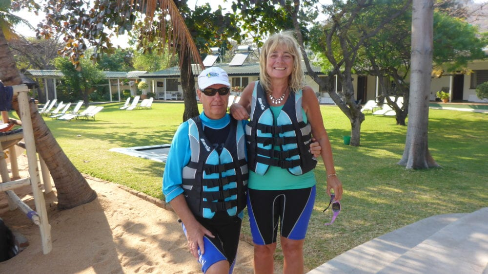 Sue and Howard in shorts and life jackets ready for sailing