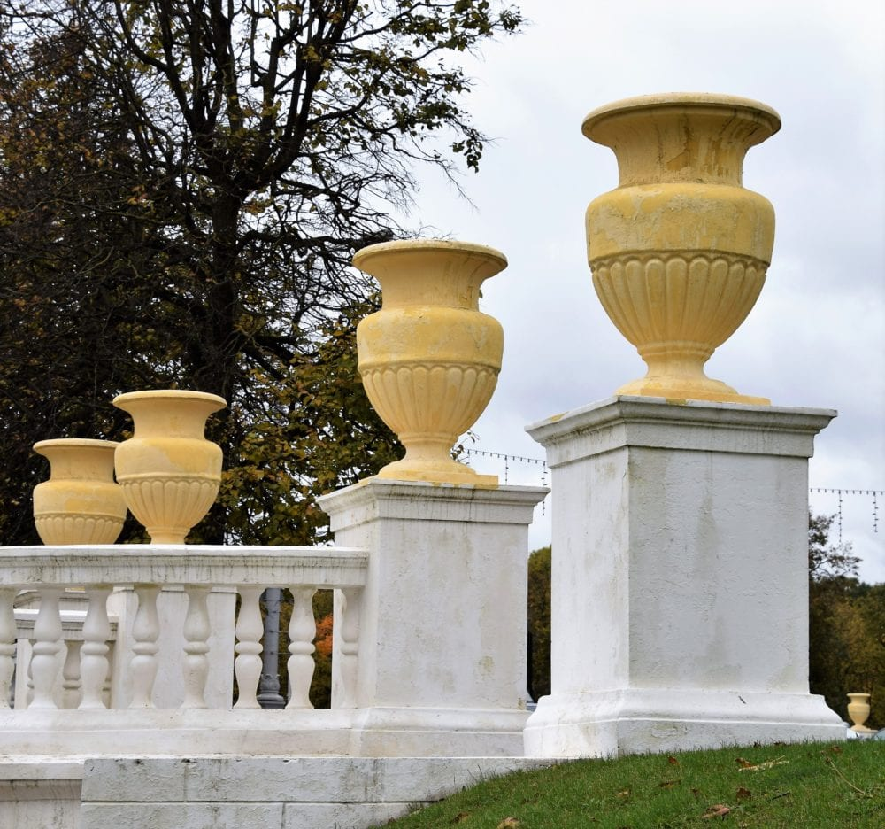 Decorative yellow urns on a balustrade in a park in Minsk