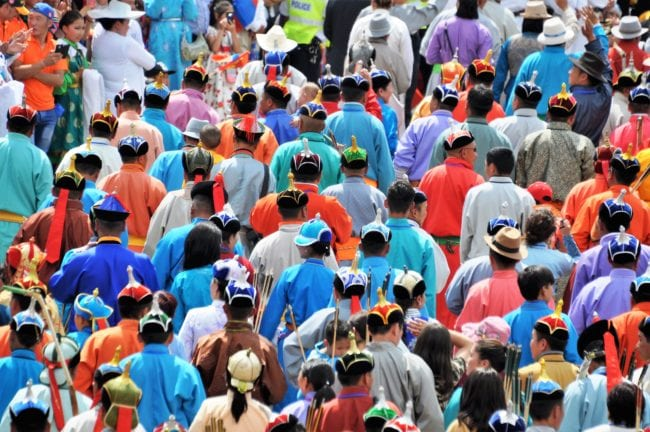 The crowd, wearing traditional costume at the Naadam games seen from above, Mongolia