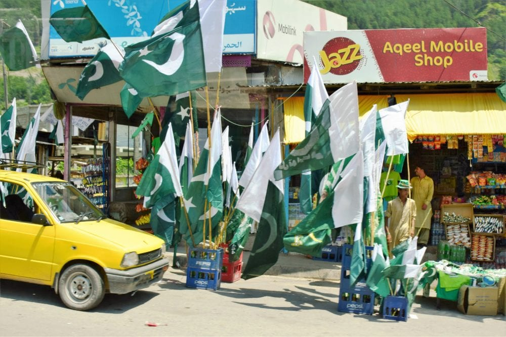 A shop selling lots of Pakistani flags
