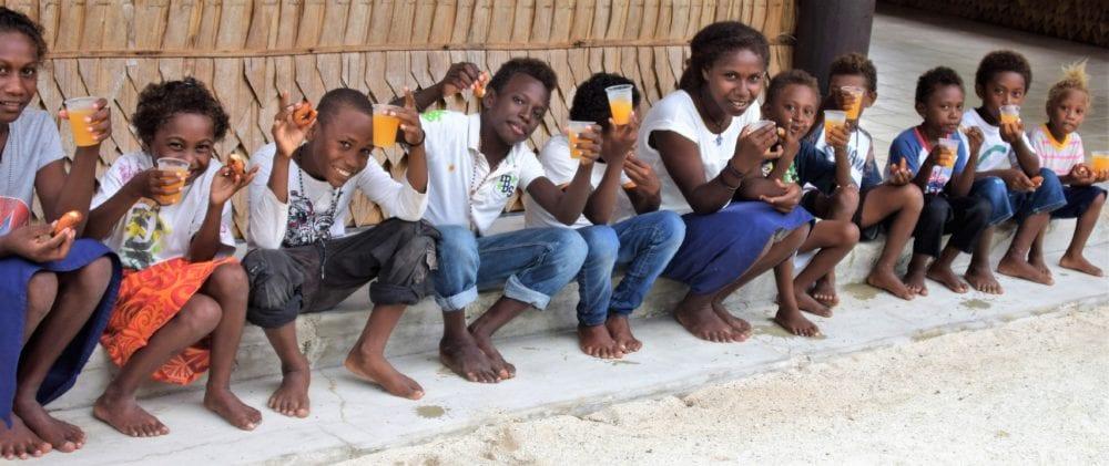 The children's choir at Tavanipupu relax with orange squash