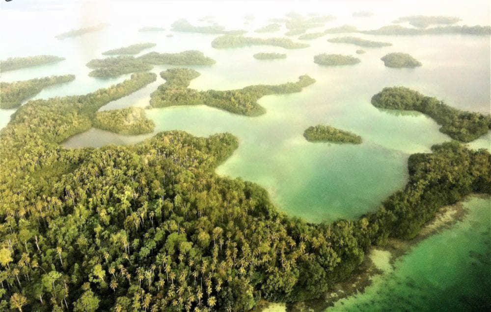 Many green islets from the air in the Solomon Islands