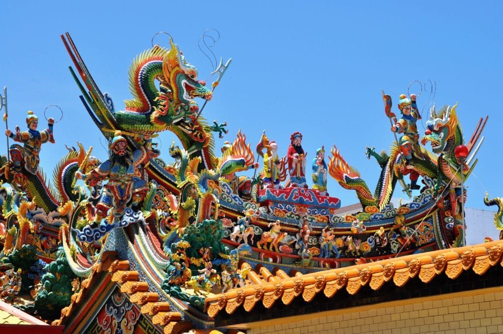 Painted carved decoration on the roof of a Tao temple in Taiwan