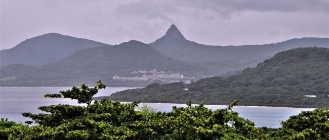 A cloud covered volcanic peak viewed from Eluanbi Lighthouse Taiwan