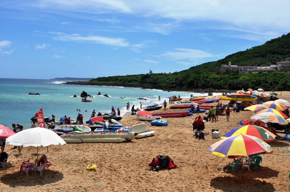 An umbrella covered stretch of golden beach, south eastern Taiwan