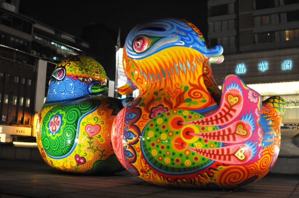 Large ornamental and brightly painted ducks in Taipei