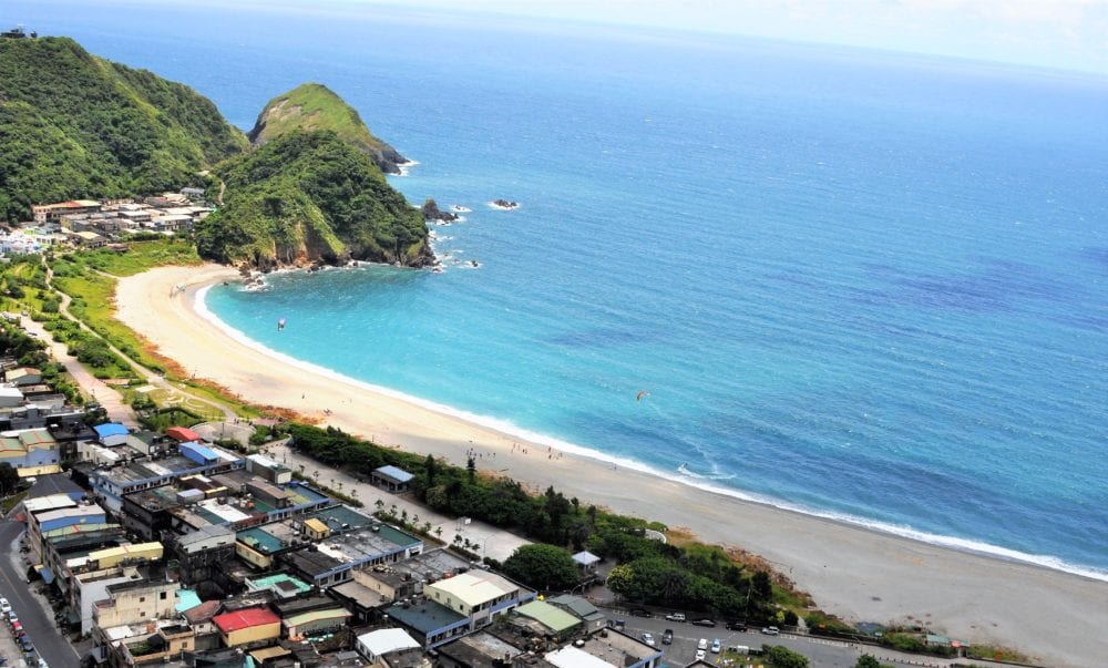 The view of the curving golden beach from Nangfao lookout, Taiwan