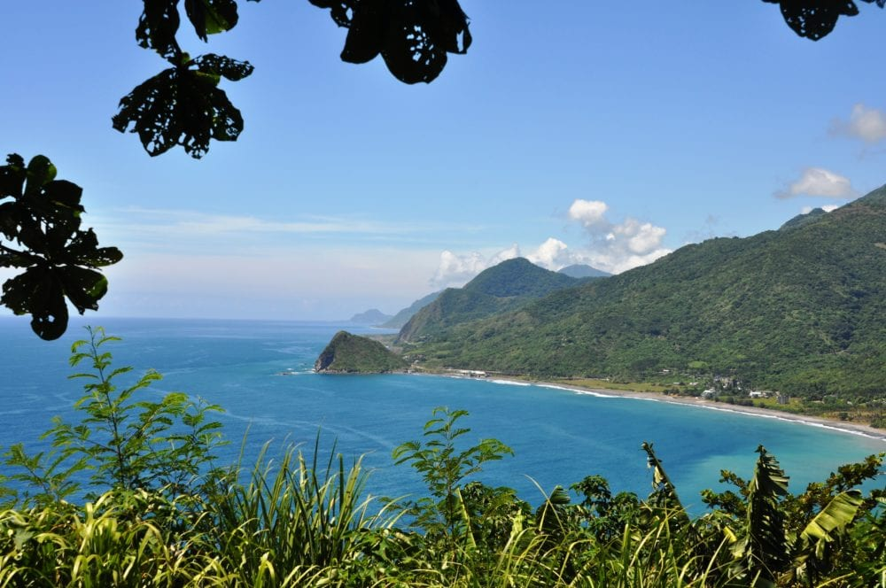 East coast pf Taiwan- a view of green mountains and a strip of beach