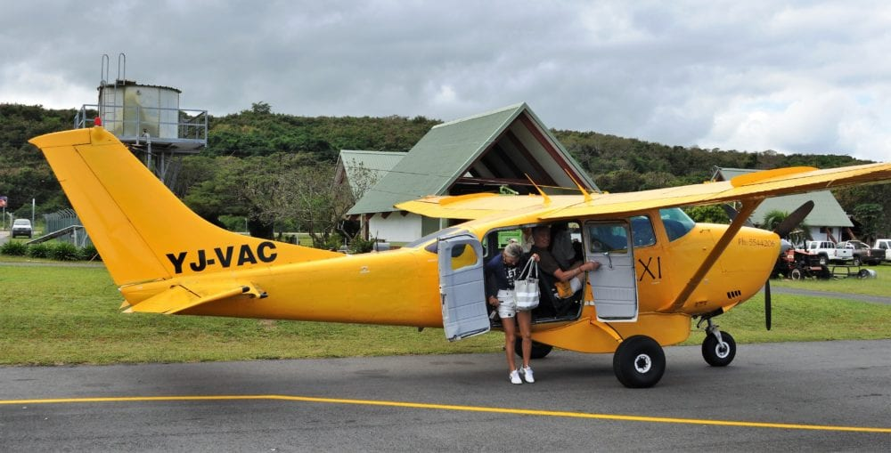 Tourists descending from our small yellow plane at Tanna
