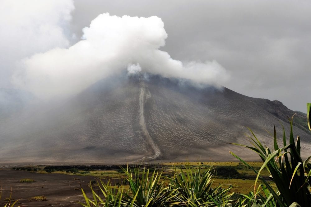 A view of Mount Yasur as we approach, smoke billowing rom the crater, Vanuatu