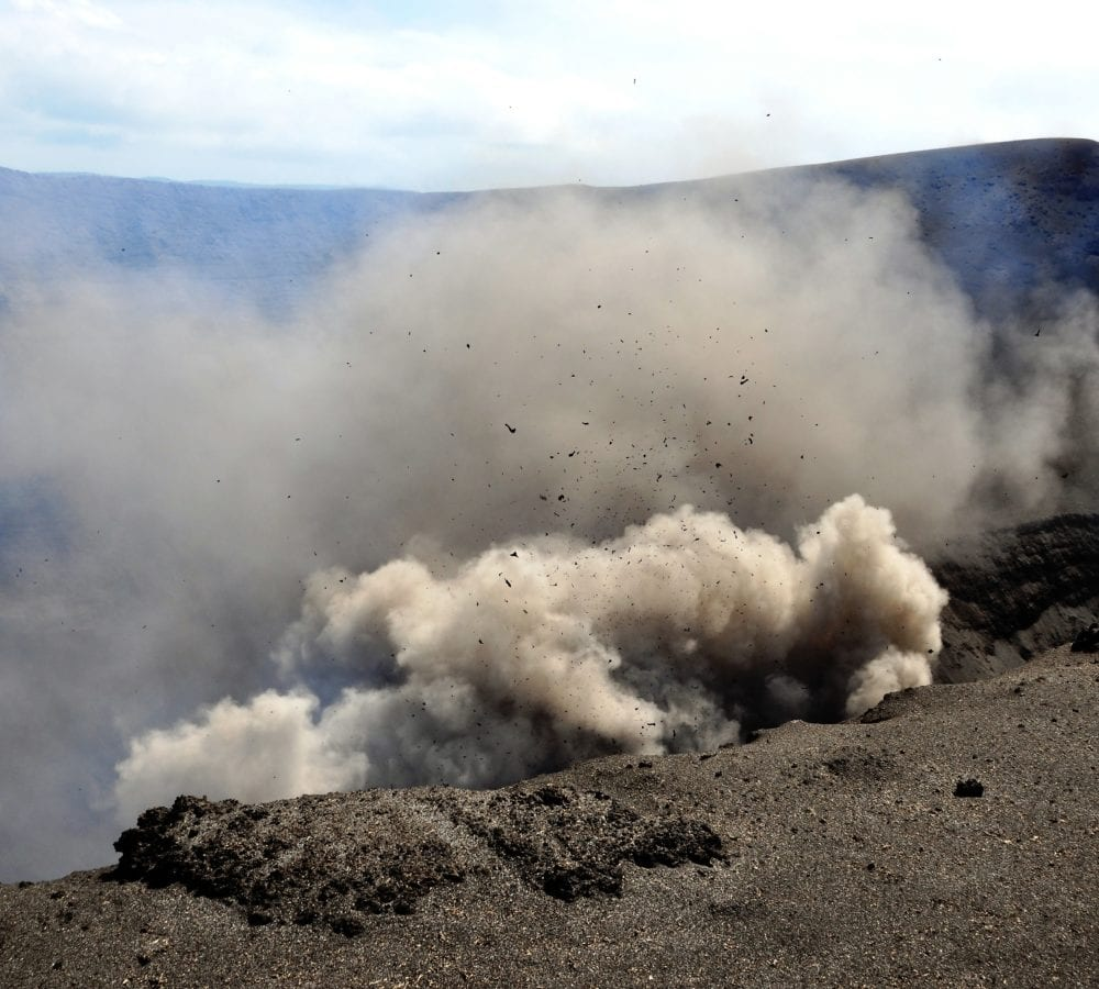 Mount Yasur-a cloud of smoke, ash and glowing lava creeping over the crater edge, Tanna