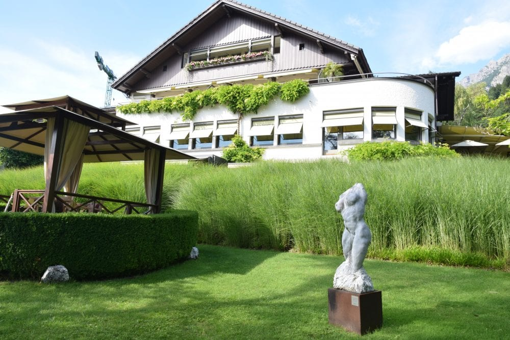 View of the hotel in Vaduz looking up from the lawn