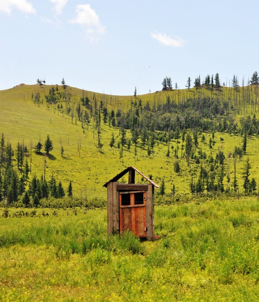 Isolated toilet in a field in Mongolia