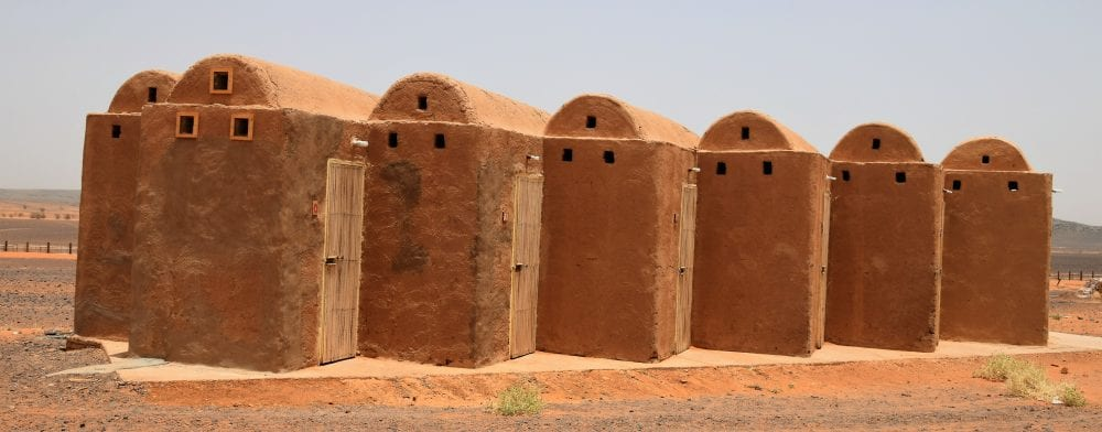 Red clay tomb style toilet cubicles in Sudan