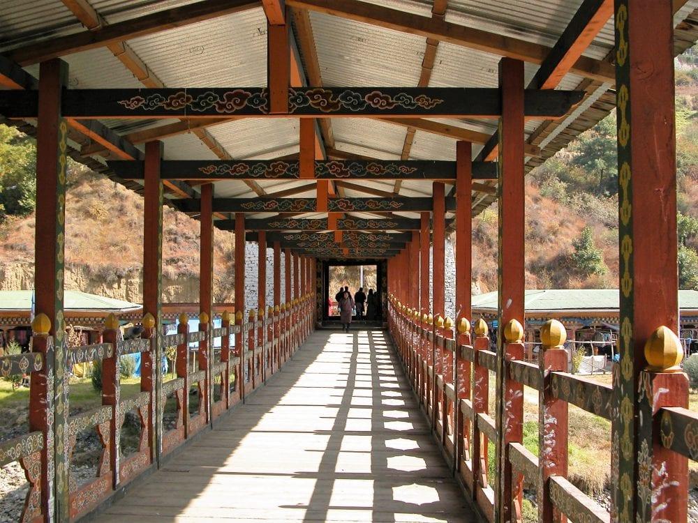 A view along the ancient decorated bridge at Punakha Dzong