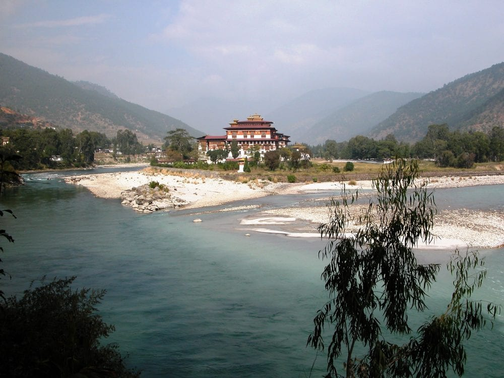 Punakha Dzong situated between two ice blue rivers