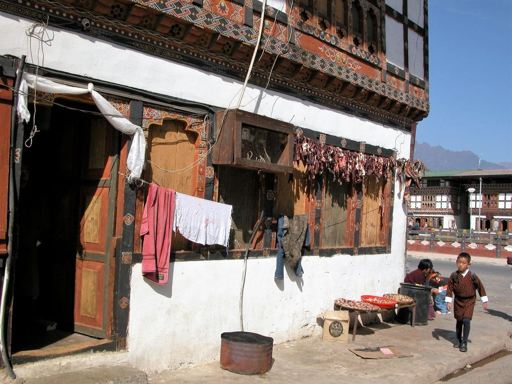 Drying chillies hmag above the shutters of a shop in Bhutan