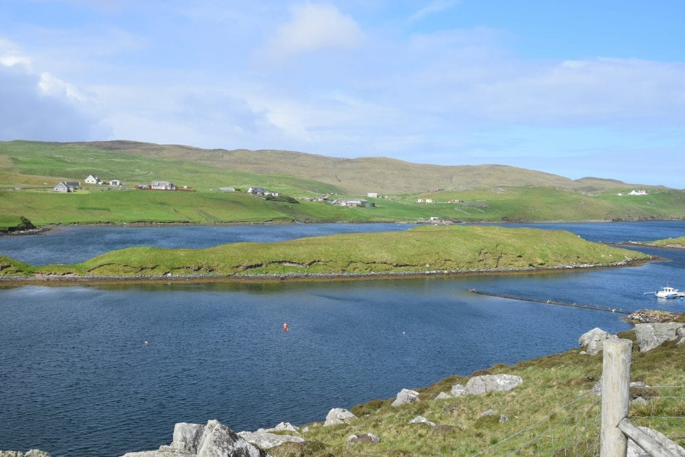 View across voe and islands at Muckle Roe, Shetland