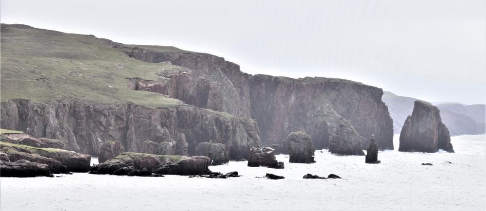 Stacks shrouded in mist off the coast of Esha Ness Shetland