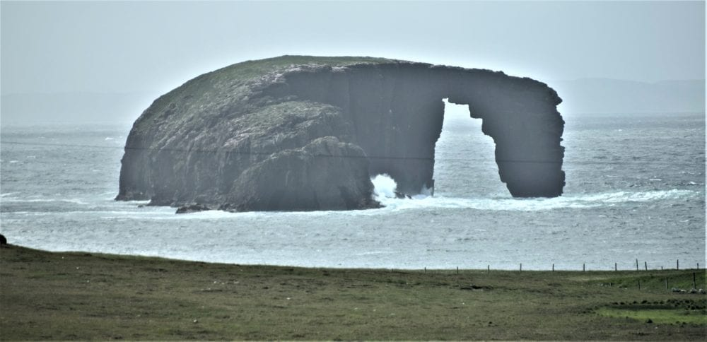 Dore Holm arch off the coast of Stenness Scotland