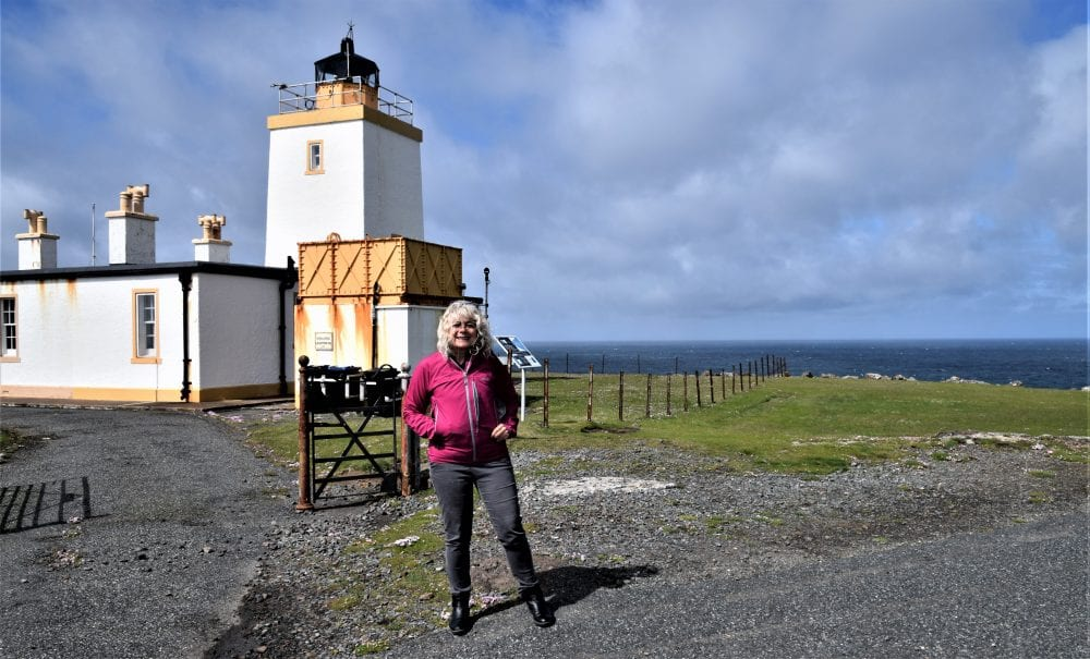 Sue in front of the Stevenson lighthouse at Esha Ness