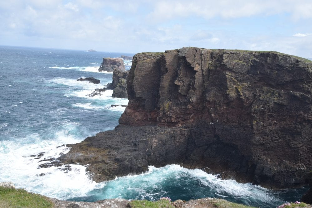 Foaming seas and sheer cliffs at Esha Ness Scotland