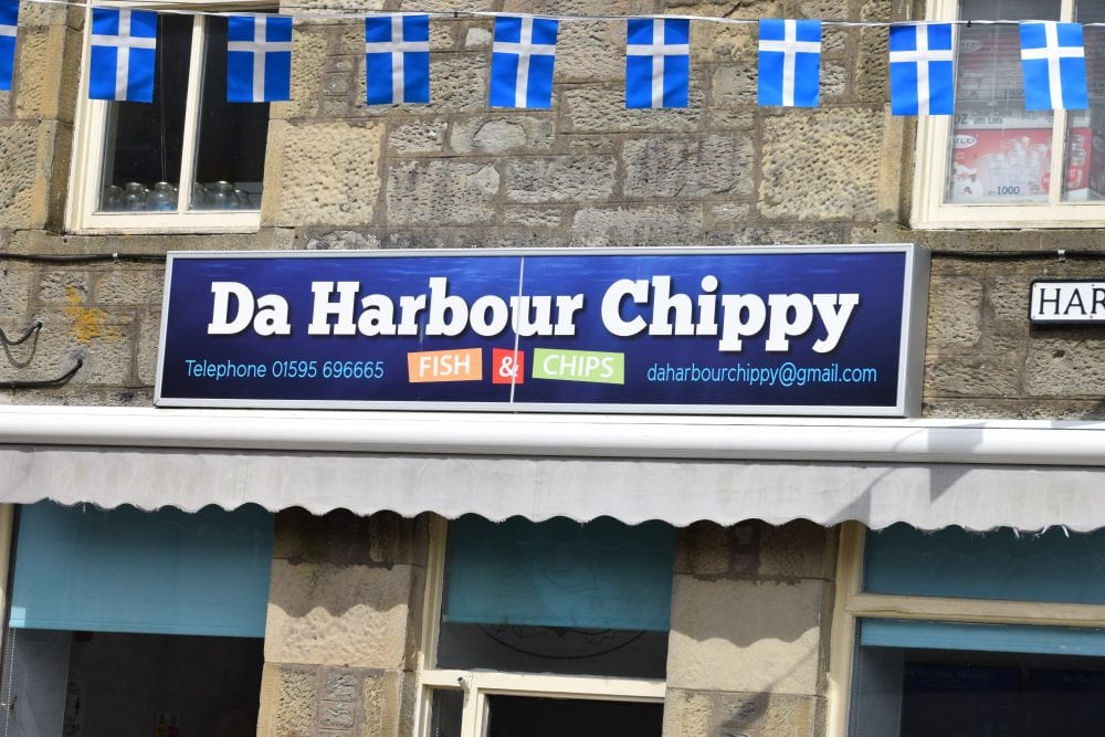 Fish and chip shop sign in Lerwick, Da Harbour Chippy