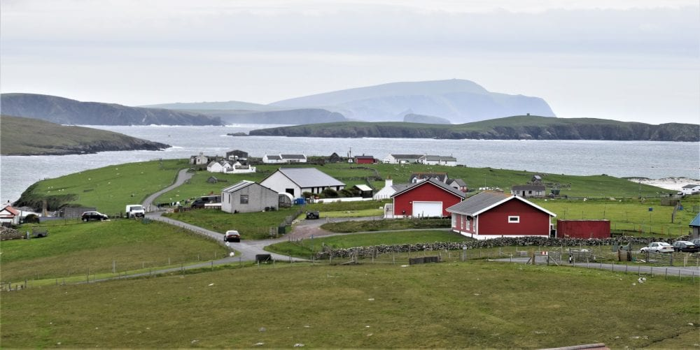 A view across houses, islets and the voe at the top of West Burra, Shetland