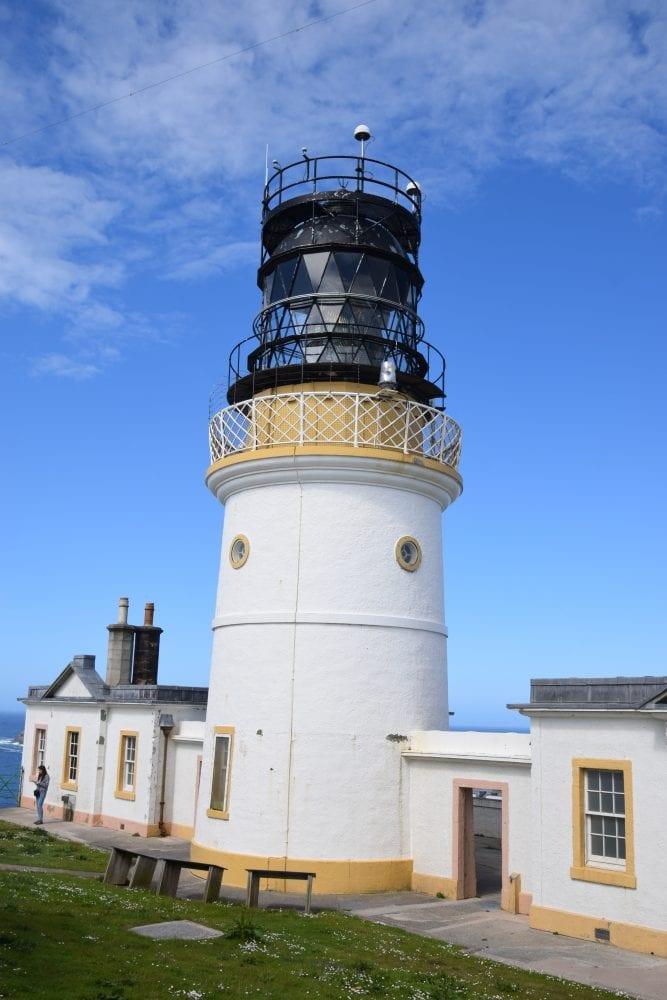 The lighthouse at Sumburgh Head, Shetland framed by a blue sky