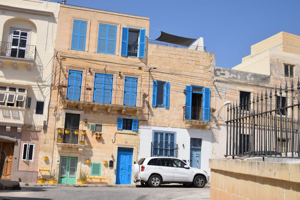 Blue shutters in a quiet street in Malta