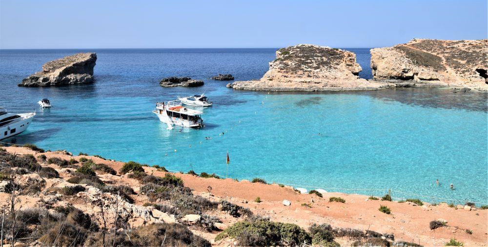 Crystal clear turquoise water and rock formations in the Blue Lagoon, Comino, Malta