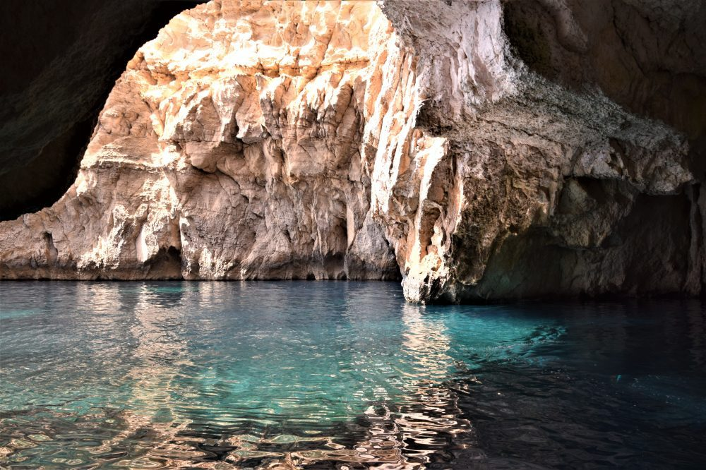 Turquoise water inside the Blue Grotto, Malta