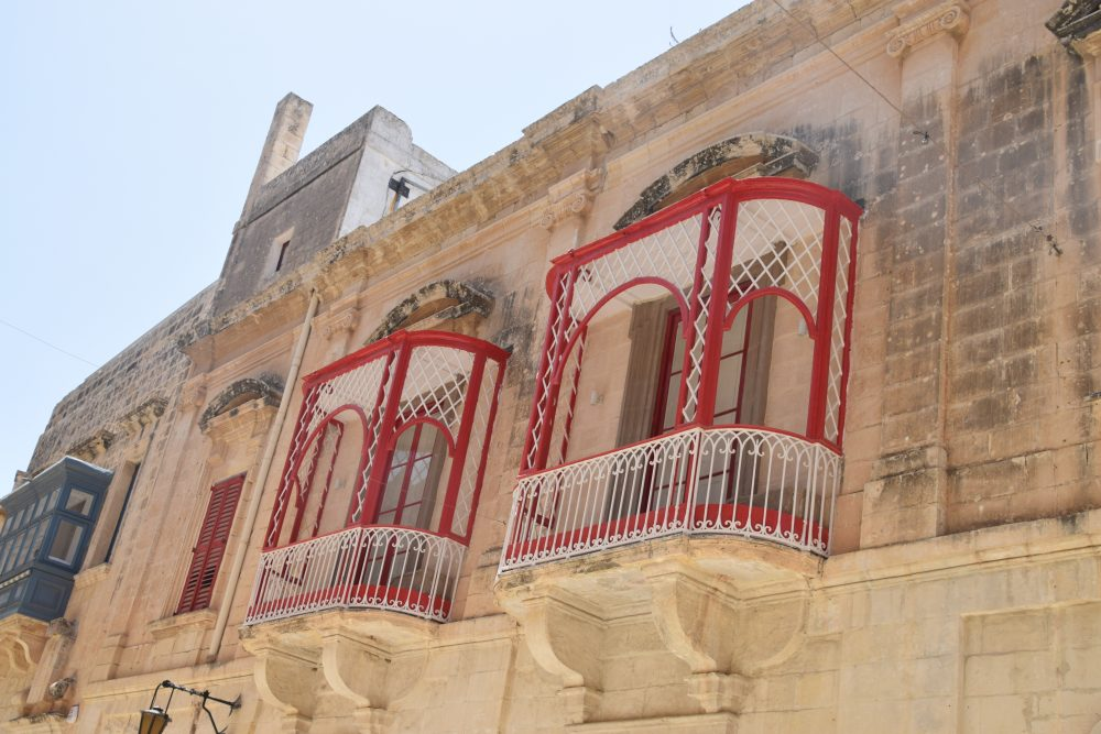 Red and white decorated balconies in Mdina, Malta