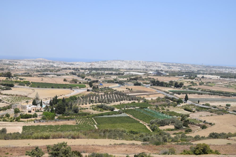 The view to the coastal cities and the sea from the fortifications at Mdina, Malta