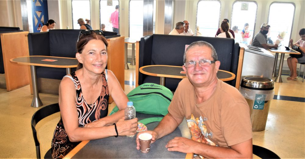 Josie and her husband Mark sitting at a table on the Gozo ferry